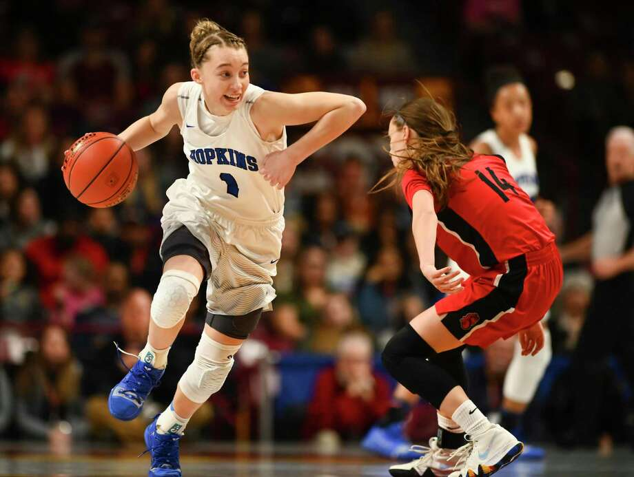Hopkins (Minn.) guard Paige Bueckers, left, is defended by Stillwater guard Sara Scalia in the state 4A championship game in March 2019. Photo: Star Tribune Via Getty Images / Copyright-2019 Image Star Tribune Copyright-2019 Image Star Tribune