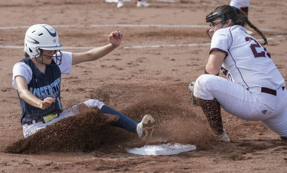 Greenwood's Jaydn Espinoza safely slides into third on a steal as Lee High's Chasity Trevino tries to make the tag 03/09/2020 at Gene Smith Field at LHS. Tim Fischer/Reporter-Telegram