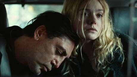 "Javier Bardem and Elle Fanning star in ""The Road Not Taken."""