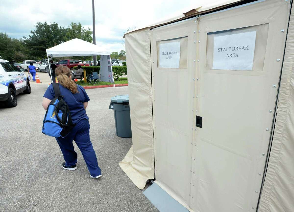 A Veterans' Affairs employee enters a tent being temporarily used as a break room at the Organization's Beaumont office Friday. Several mobile units and military tents are being used to treat patients until the building is renovated from Tropical Depression flooding. Repairs are expected to take months. Photo taken Friday, 9/27/19
