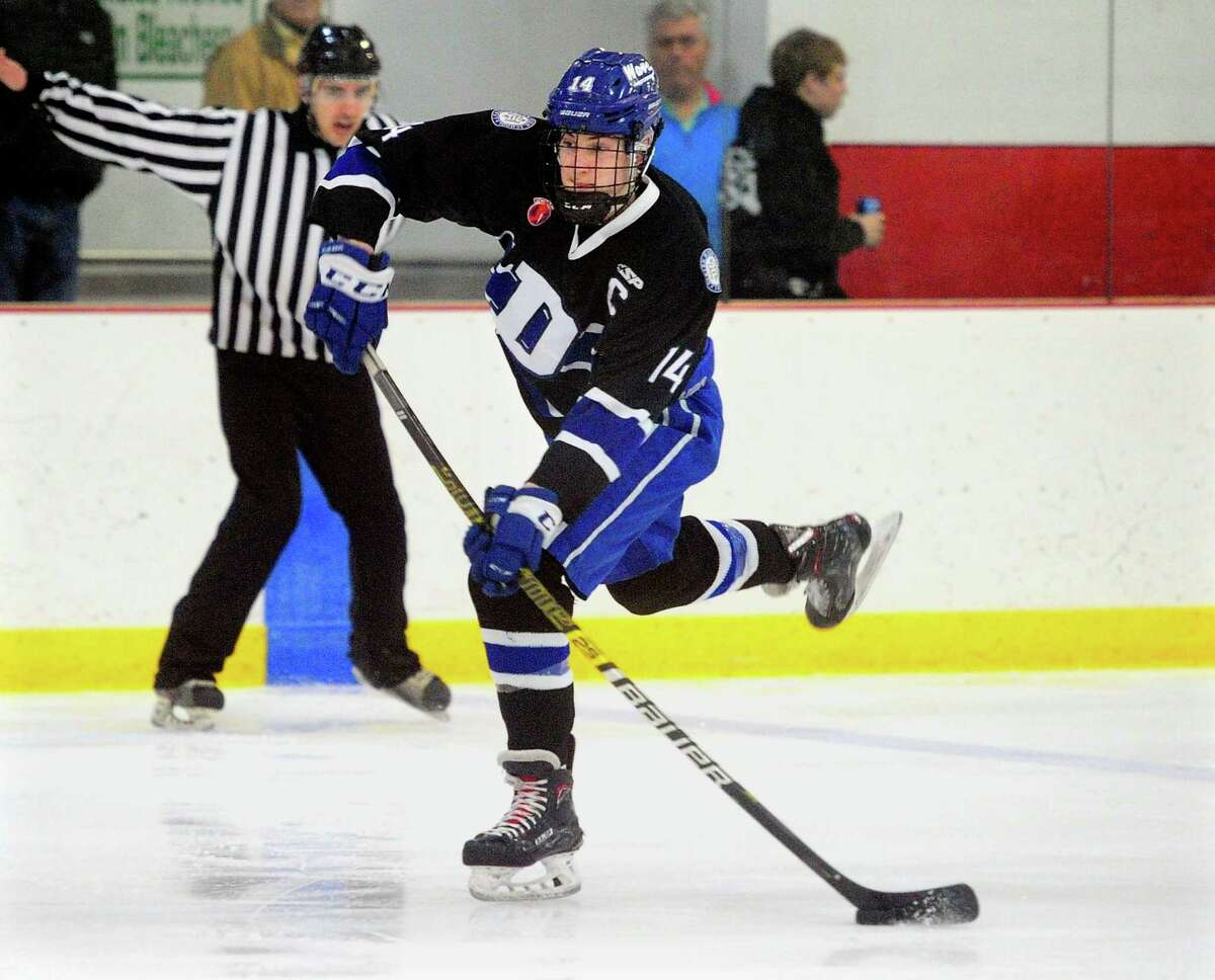 Darien's Jack Massey (14) attempts a goal shot during FCIAC boys hockey championship action against New Canaan in Greenwich, Conn., on Saturday Mar. 7, 2020.