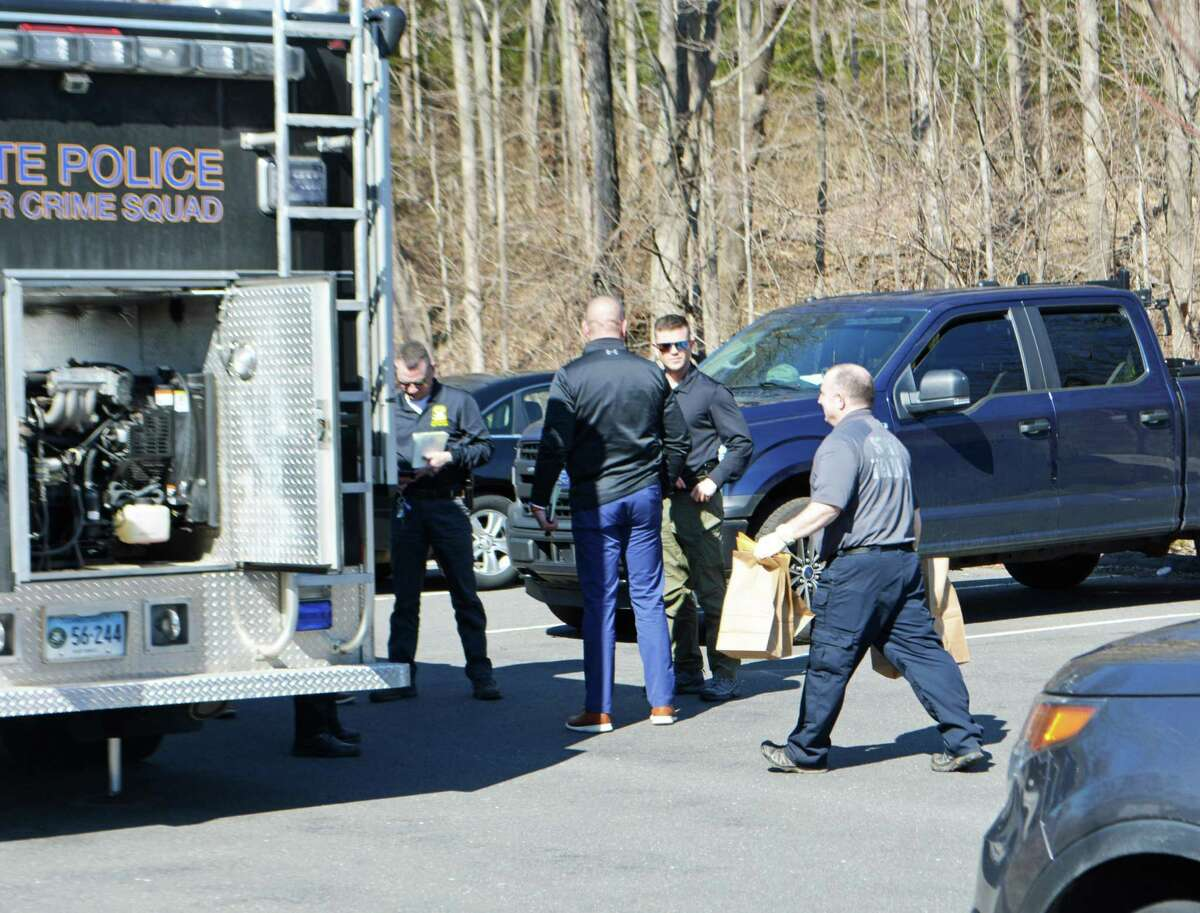 Connecticut state police and other investigators work the scene March 9 on the Middlefield side of Wadsworth State Falls State Park, where a woman in her 30s was found dead.