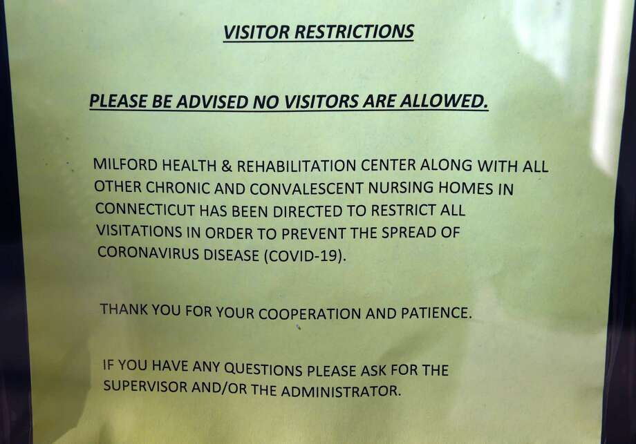 A sign posted on the front door of the Milford Health and Rehabilitation Center restricts visitors to prevent the spread of coronavirus (COVID -19) on March 9, 2020. Photo: Arnold Gold / Hearst Connecticut Media / New Haven Register