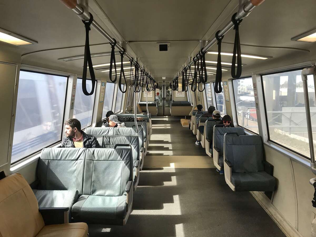 Passengers ride BART just before the train enters the Transbay Tube in Oakland last year.