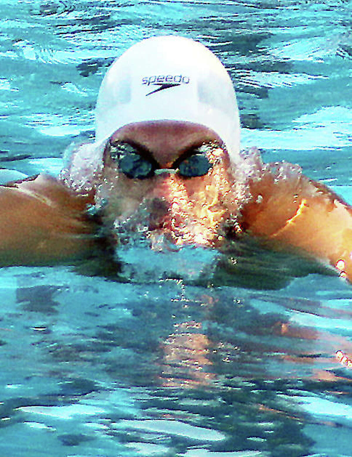 Noah Clancy of the TCAY Tidalwaves, above, and teammates Erick Humphrey and Anna Moehn, each had seven individual event first-place finishes at the Heartland regional meet over the weekend at Principia College.