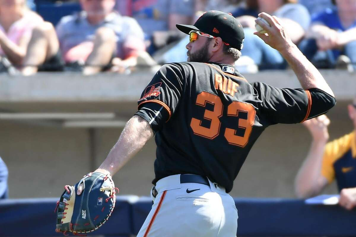 MARYVALE, ARIZONA - MARCH 06: Darin Ruf #33 of the San Francisco Giants throws the ball to first base against the Milwaukee Brewers during a spring training game at American Family Fields of Phoenix on March 06, 2020 in Maryvale, Arizona. ~~