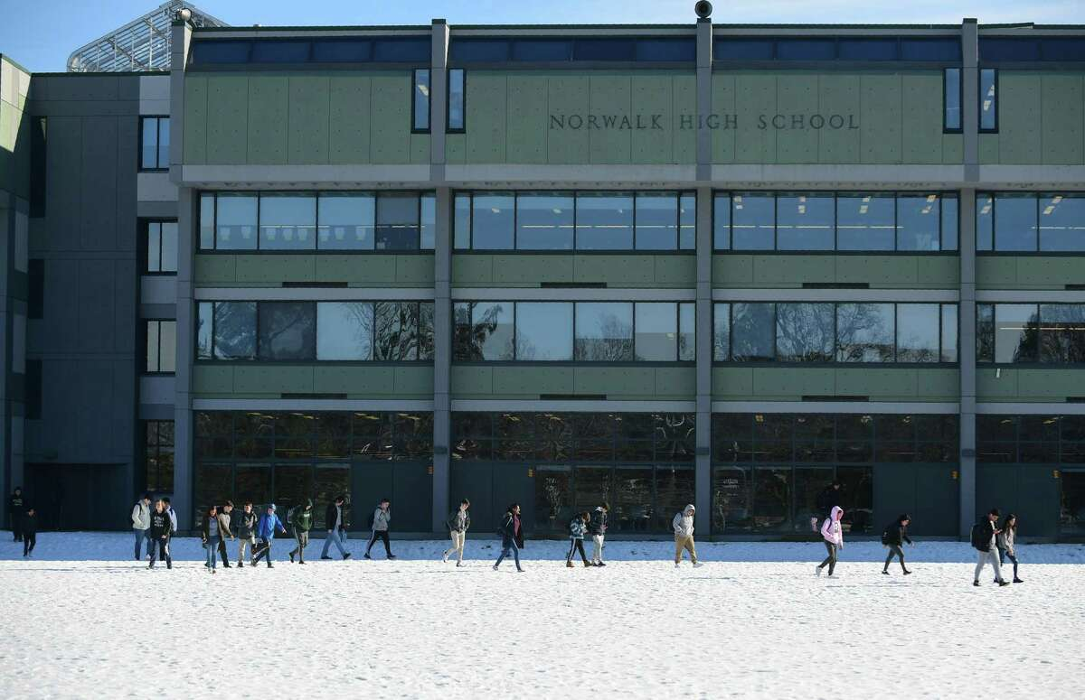 Students leave Norwalk High School Friday, January 24, 2020, in Norwalk, Conn.The city has proposed building a brand new high school in a deal where 80 percent of the cost will be covered by the state.