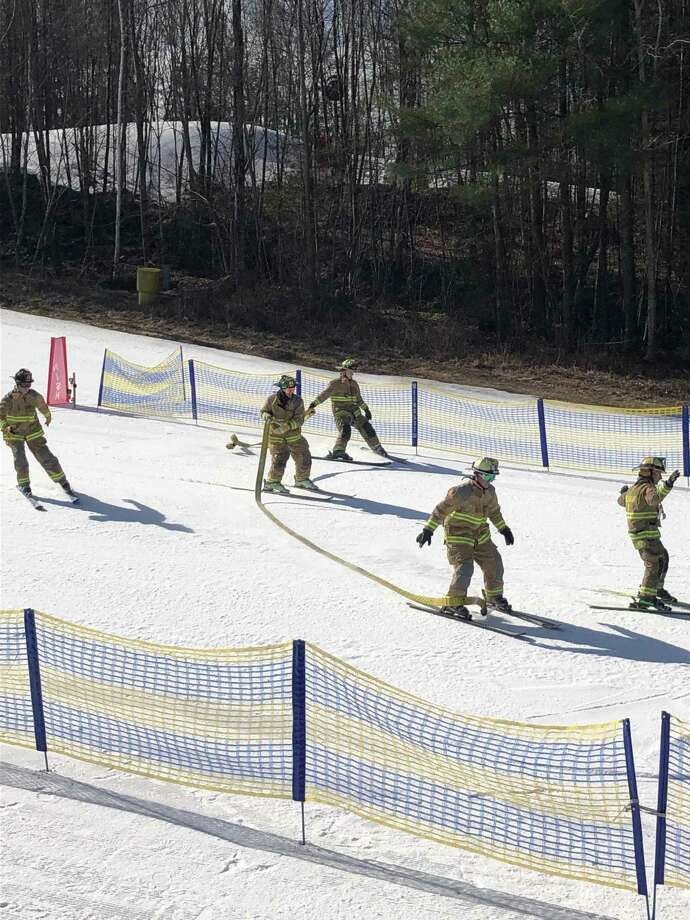 The annual Firemen's ski race was held Sunday at Mohawk Mountain. The competition raised $1,000 for the Connecticut Burn Center. Photo: Tom Mitchell / Contributed Photo /