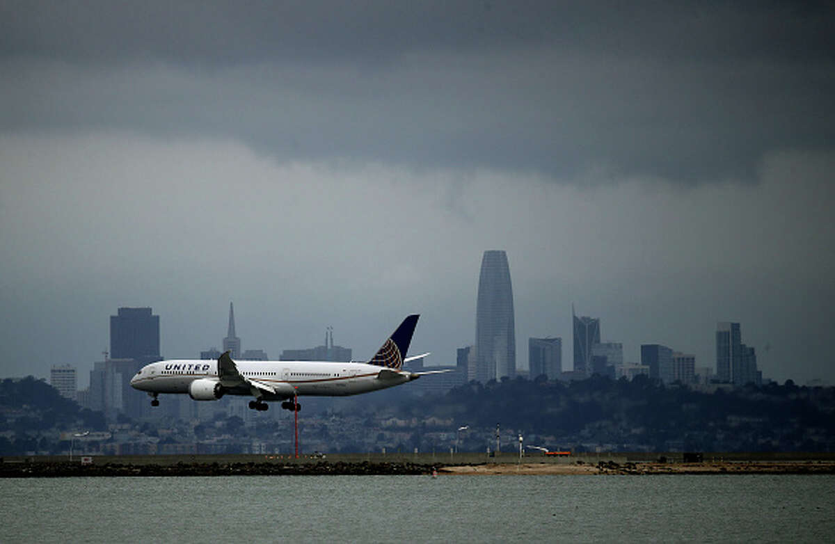 A United Airlines plane lands at San Francisco International Airport. In the wake of the COVID-19 outbreak, airlines are facing significant losses as people are canceling travel plans and businesses are restricting travel.
