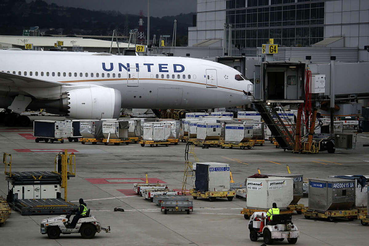 FILE: A United Airlines plane sits parked at a gate at San Francisco International Airport on March 6, 2020 in San Francisco.