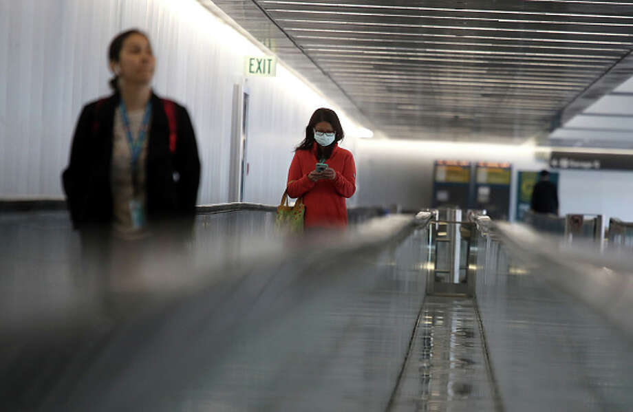United airlines now requires passengers to wear masks in airport terminals, or face results. Photo: Justin Sullivan/Getty Images / 2020 Getty Images