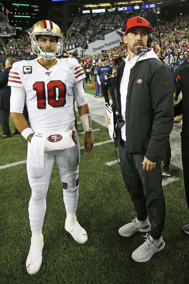 SEATTLE, WA - DECEMBER 29: Jimmy Garoppolo #10 and Head Coach Kyle Shanahan of the San Francisco 49ers stand on the sideline during the game against the Seattle Seahawks at CenturyLink Field on December 29, 2019 in Seattle, Washington. The 49ers defeated Photo: Michael Zagaris, Getty Images