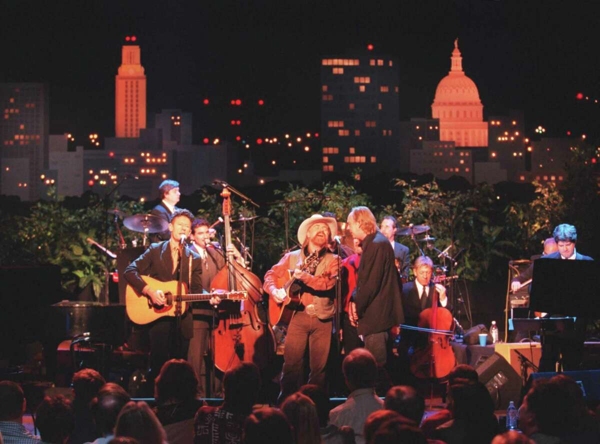 Lyle Lovett performs with Michael Martin Murphy and Eric Taylor during a taping of Austin City Limits, in 2000.