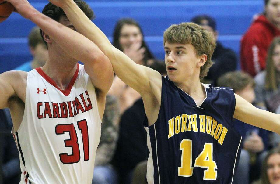 The Kingston Cardinals opened the 2019-2020 MHSAA district tournament with a 72-33 win over North Huron on Monday night. Photo: Mark Birdsall/Huron Daily Tribune