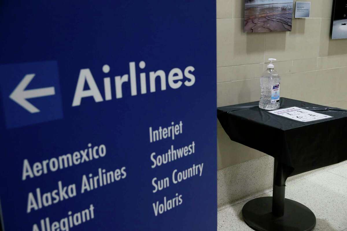 Bottles of hand sanitizers are available in 10 highly trafficked spots at the San Antonio International Airport, Monday, March 9, 2020. According to airport spokesperson, Tonya Hope, enhanced cleaning of surface areas has been increased as well as their routine cleaning regiment.