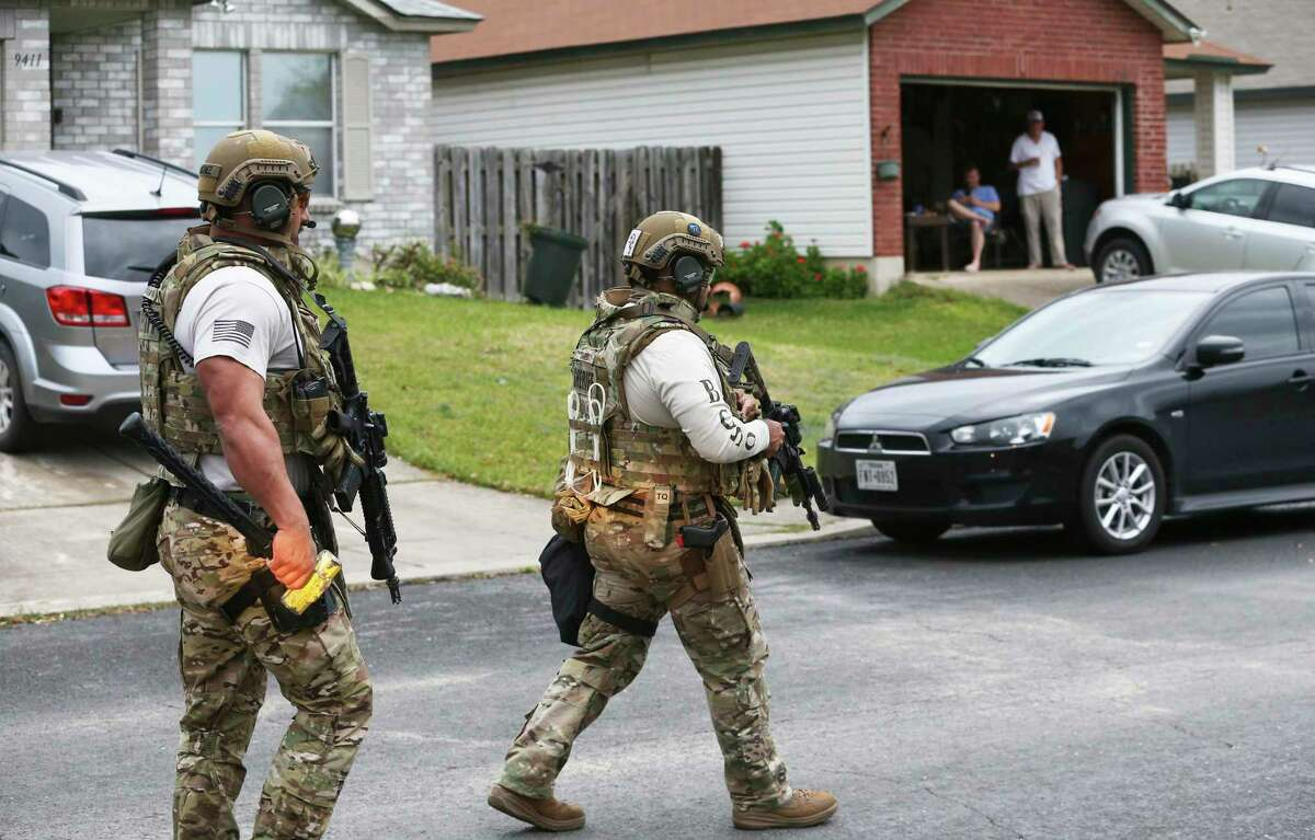 Sheriff's Department SWAT officers move in to apprehend a subject held up in the backyard of a home in the 9500 block of Bending Crest on Feb. 9, 2020.