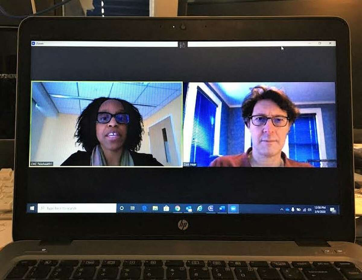 PsychiatristDr. Tichianaa Armah, left, conducted a simulated treatment session with Hearst Connecticut Media Columnist Dan Haar, Monday, March 9, 2020, as her employer, Community Health Center Inc., works to persuade the state to allow reimbursement for tele-medicine visits under Medicaid.