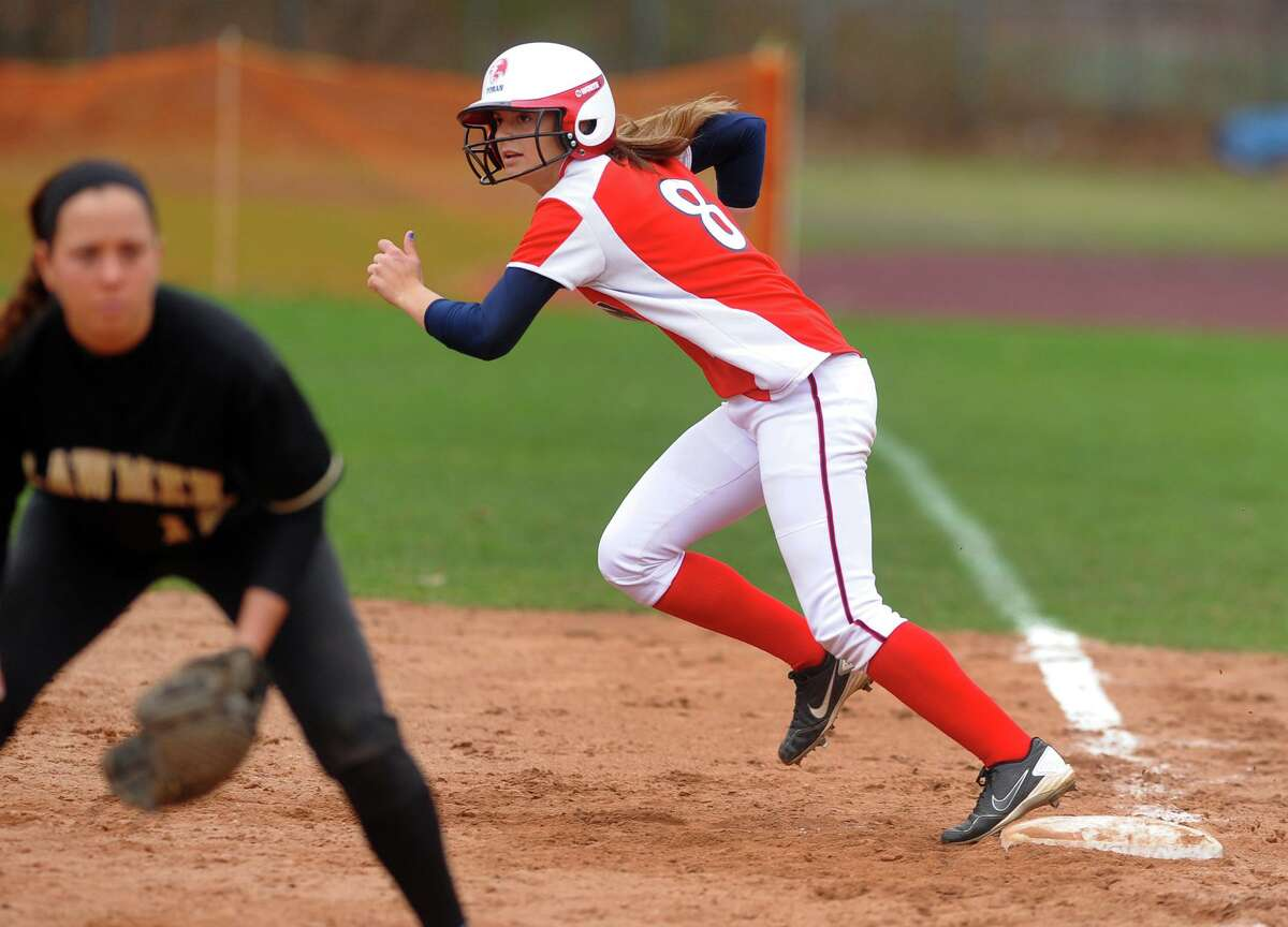 Foran's Danielle Kemp steps off first, during softball action against Jonathan Law in Milford, Conn. on Friday April 19, 2013.