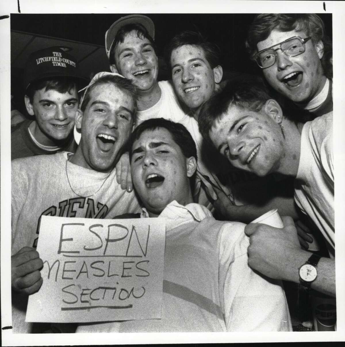 Siena measles rooting section students watched from the campus center as their team beat Boston University in an empty arena in Hartford, Conn. in the North Atlantic Conference title game on March 11, 1989. (Times Union archive)