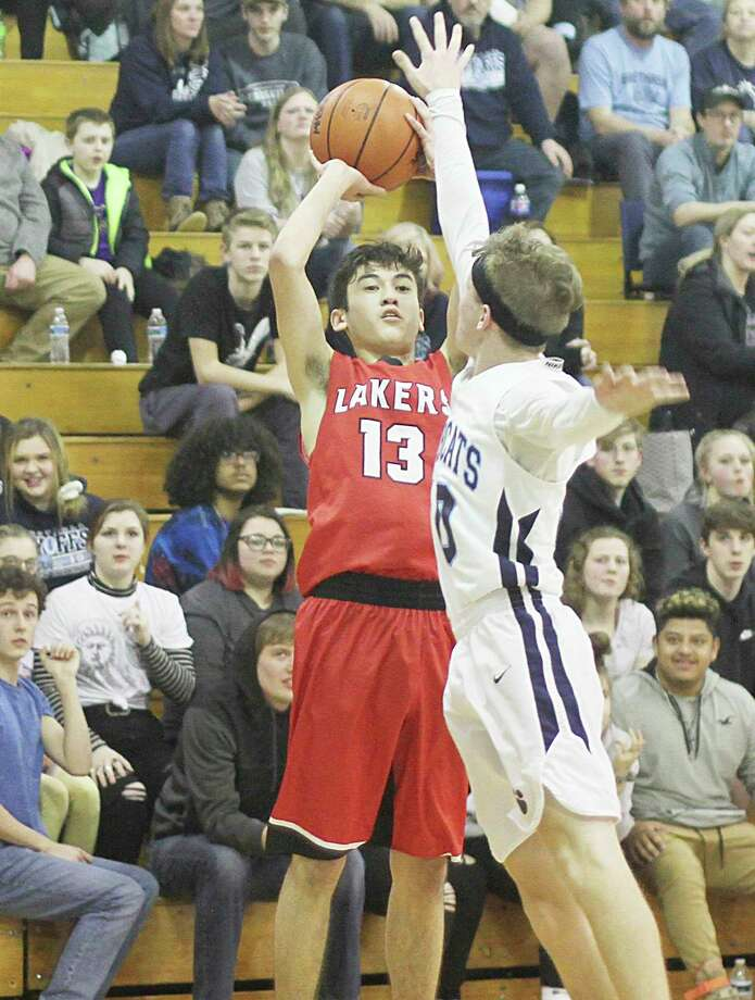 Bear Lake's Tai Babinec shoots a jumper during the Lakers' loss to Brethren on Monday in a Division 4 district quarterfinal. (Kyle Kotecki/News Advocate)
