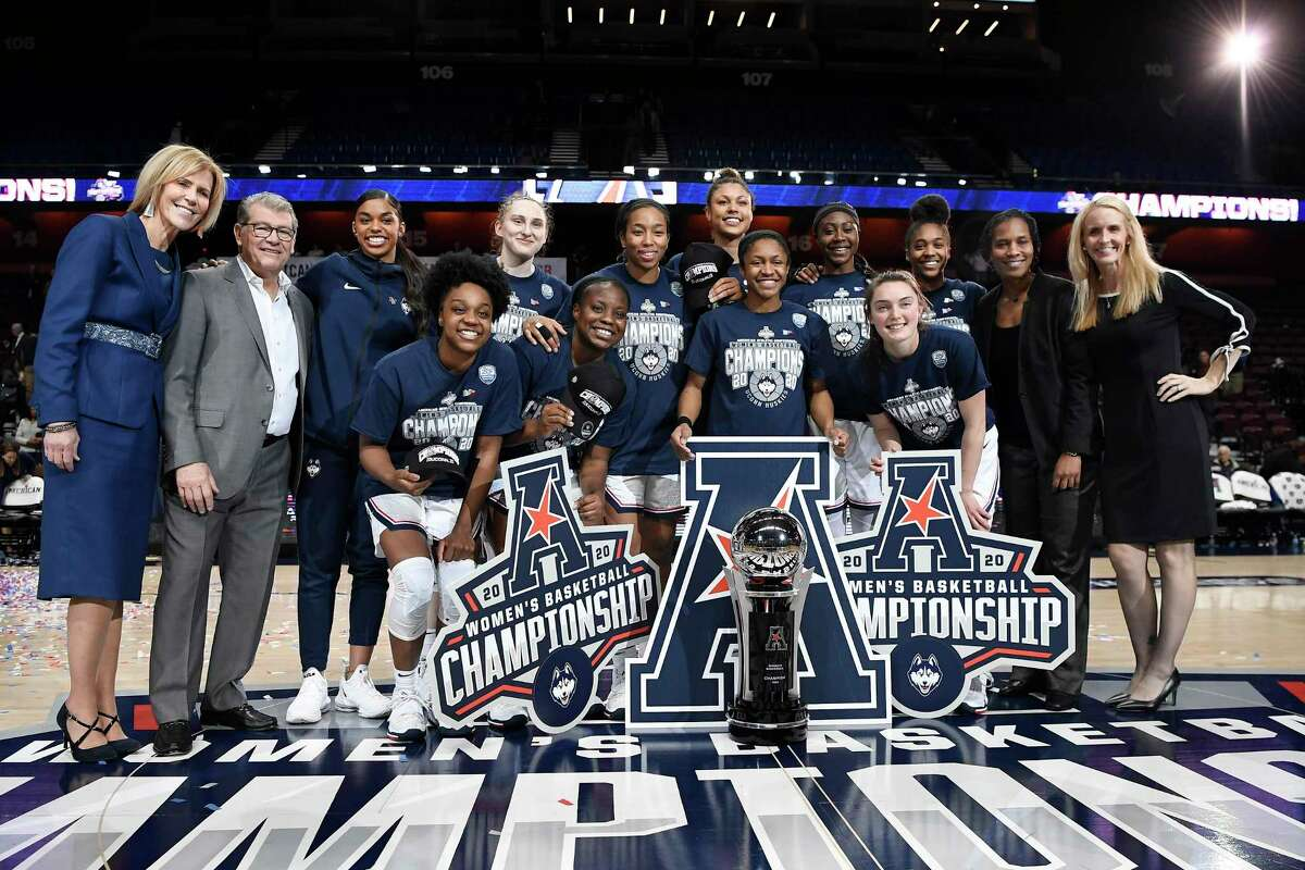 UConn poses for a team photo at the end of an NCAA college basketball game against Cincinnati in the American Athletic Conference tournament finals at Mohegan Sun Arena, Monday, March 9, 2020, in Uncasville.