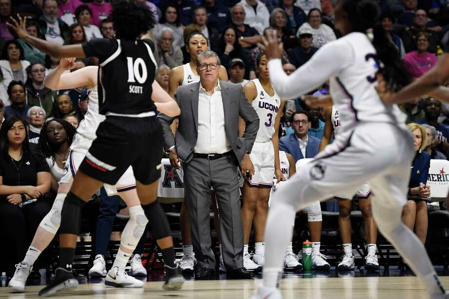 Connecticut head coach Geno Auriemma, center, watches play at the end of an NCAA college basketball game against Cincinnati in the American Athletic Conference tournament finals at Mohegan Sun Arena, Monday, March 9, 2020, in Uncasville, Conn. (AP Photo/Jessica Hill) Photo: Jessica Hill / Associated Press / Copyright 2020 The Associated Press. All rights reserved.