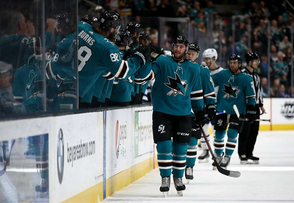 Stefan Noesen #11 of the San Jose Sharks is congratulated by teammates after he scored a goal against the Toronto Maple Leafs in the third period at SAP Center on March 03, 2020 in San Jose, California. (Photo by Ezra Shaw/Getty Images)