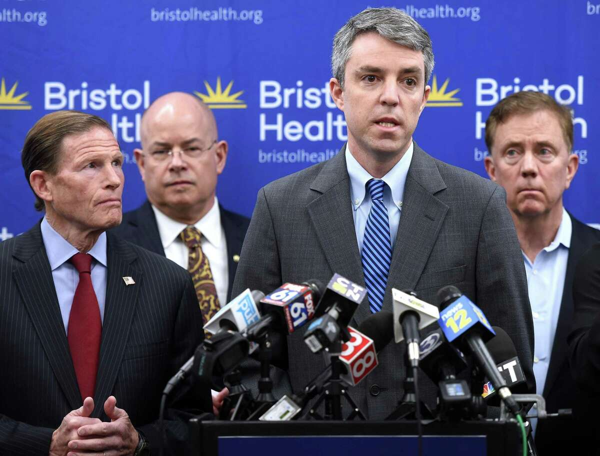 Josh Geballe (center), chief operating officer for Governor Ned Lamont, speaks about coronavirus preparedness and response efforts in the state during a press conference at Bristol Hospital on March 9, 2020. From left are U.S. Senator Richard Blumenthal, Bristol Health President and CEO Kurt Barwis, Geballe, and Governor Ned Lamont.