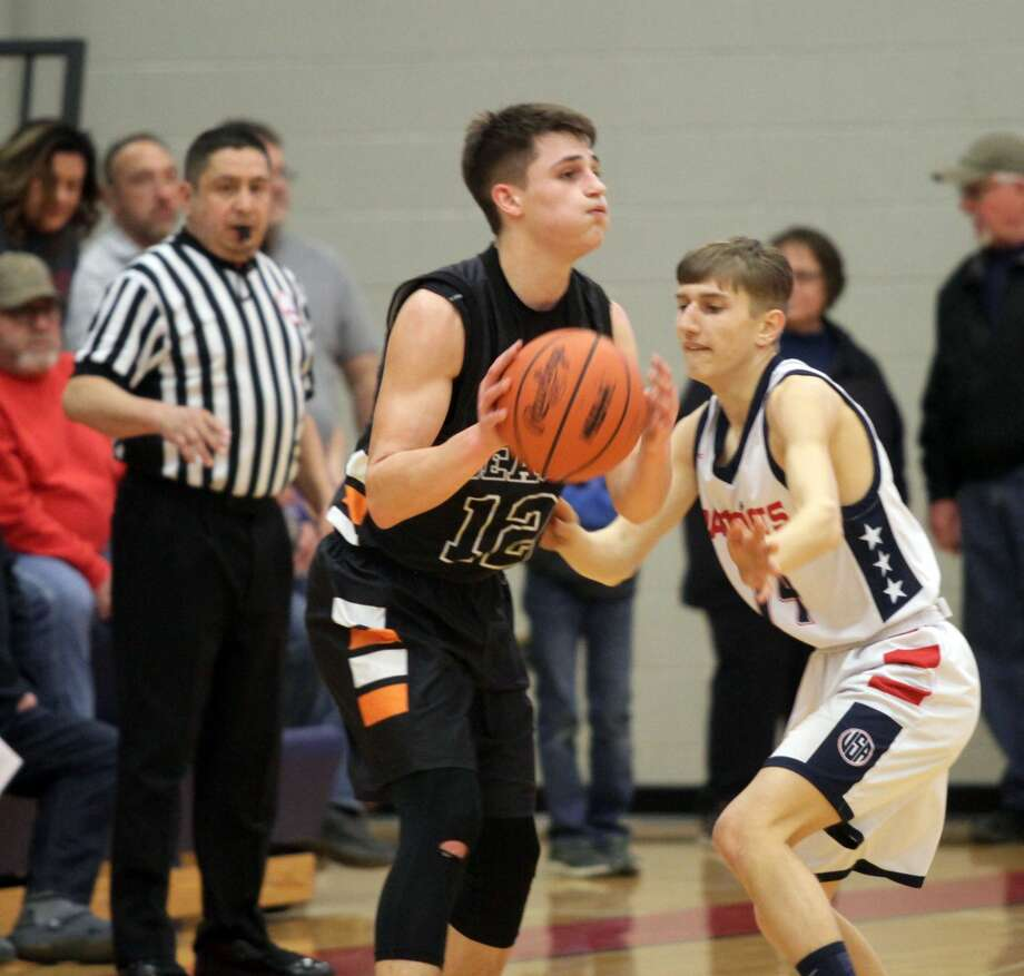 The USA boys basketball team moves onto the second of districts after a 49-44 win over Harbor Beach on Monday night. Photo: Eric Rutter/Huron Daily Tribune