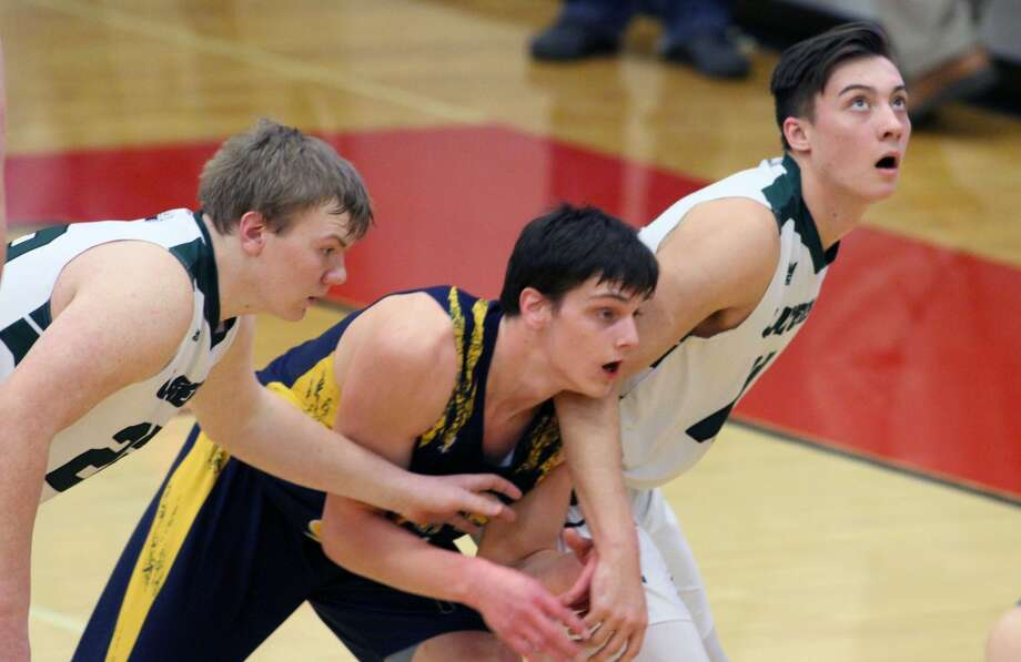 The Bad Axe boys basketball team logged a 54-41 victory over Laker in the first round of districts on Monday, March 9. Photo: Eric Rutter/Huron Daily Tribune