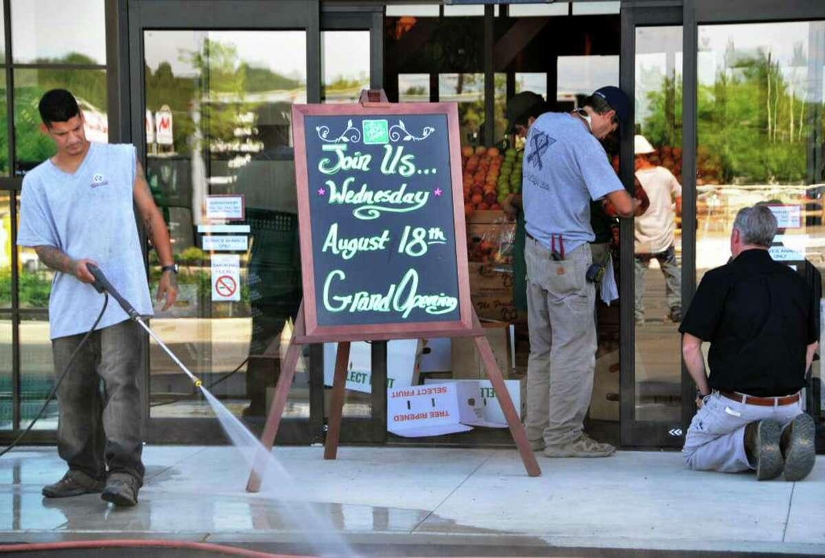 Crews prepare the entrance to The Fresh Market Tuesday. (John Carl D'Annibale / Times Union)