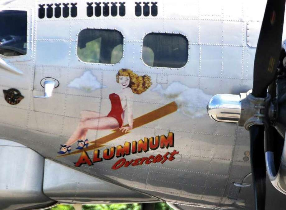 """Nose art"" on the fusilage of the WWII era B17 ?Aluminum Overcast? at the Empire State Aerosciences Museum in Glenville. Operated by the Experimental Aircraft Association, the national tour of this aircraft helps people learn about the B17 and its important contribution to the outcome of World War II. Some aircraft historians consider the B17 the most significant plane of WW II. (John Carl D'Annibale / Times Union) Photo: John Carl D'Annibale / 00009894A"