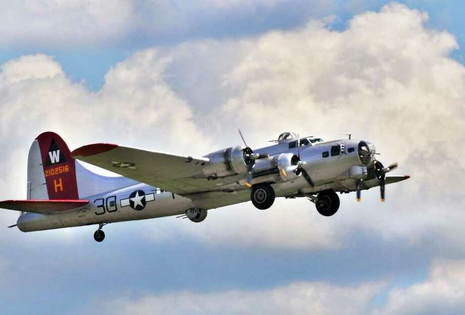 A flying museum, the WWII-era B17 ?Aluminum Overcast? takes off from the Empire State Aerosciences Museum in Glenville on Aug. 17.   (John Carl D'Annibale / Times Union) Photo: John Carl D'Annibale / 00009894A