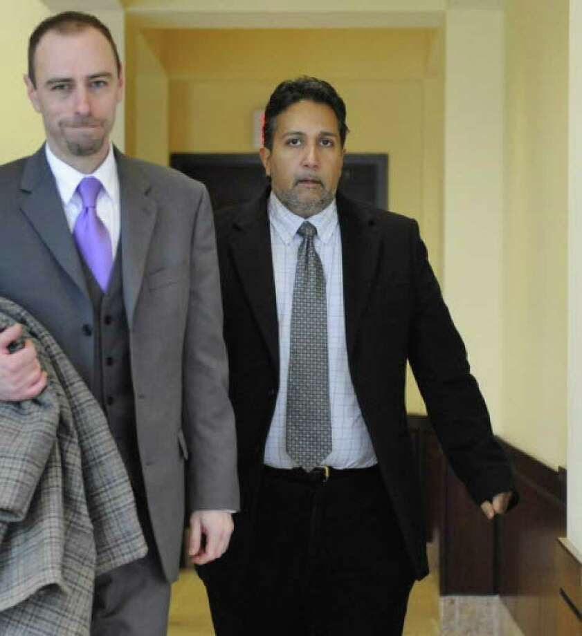 Akiva Abraham, right, and his attorney Bryan Rounds are shown at the Albany County Courthouse during Abraham's December 2009 trial. (Skip Dickstein / Times Union archive)