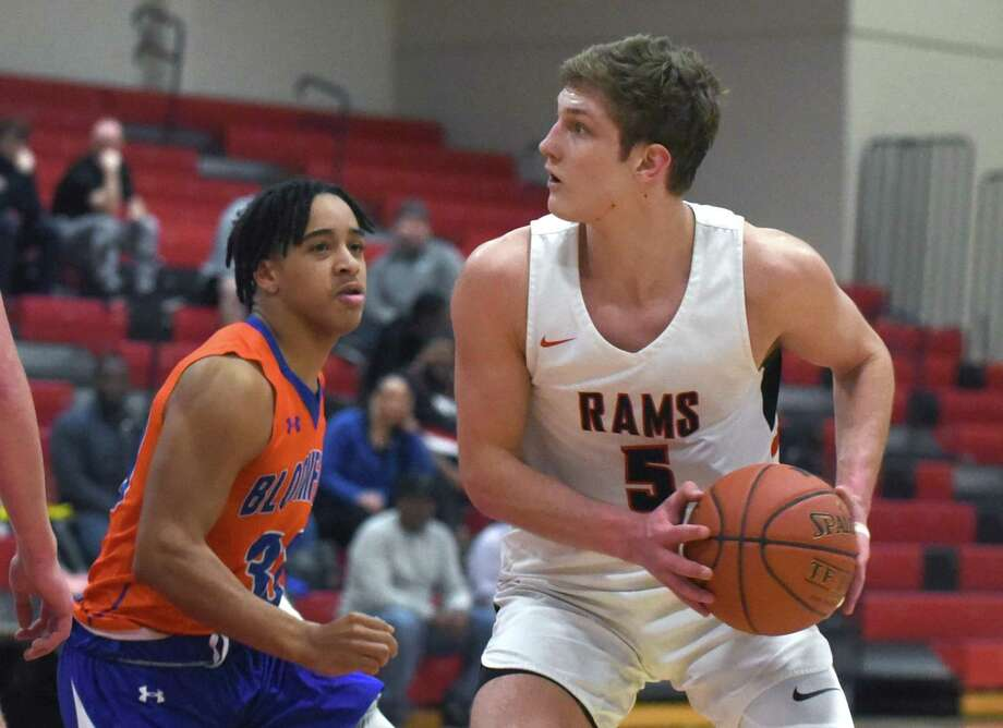 New Canaan's Alex Gibbens (5) looks for a shot while Bloomfield's Shane Bell (30) defends during the first round of the CIAC Div. III boys basketball tournament in New Canaan on Monday, March 9, 2020. Photo: Dave Stewart / Hearst Connecticut Media / Hearst Connecticut Media