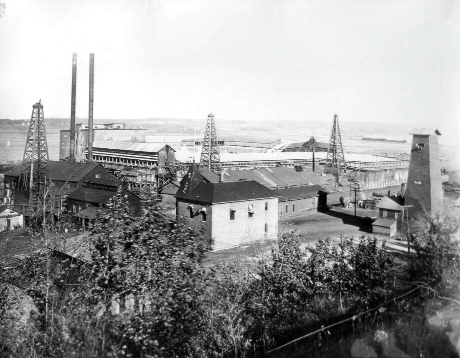 The R.G. Peters Sawmill is shown in this photograph from the 1890s.