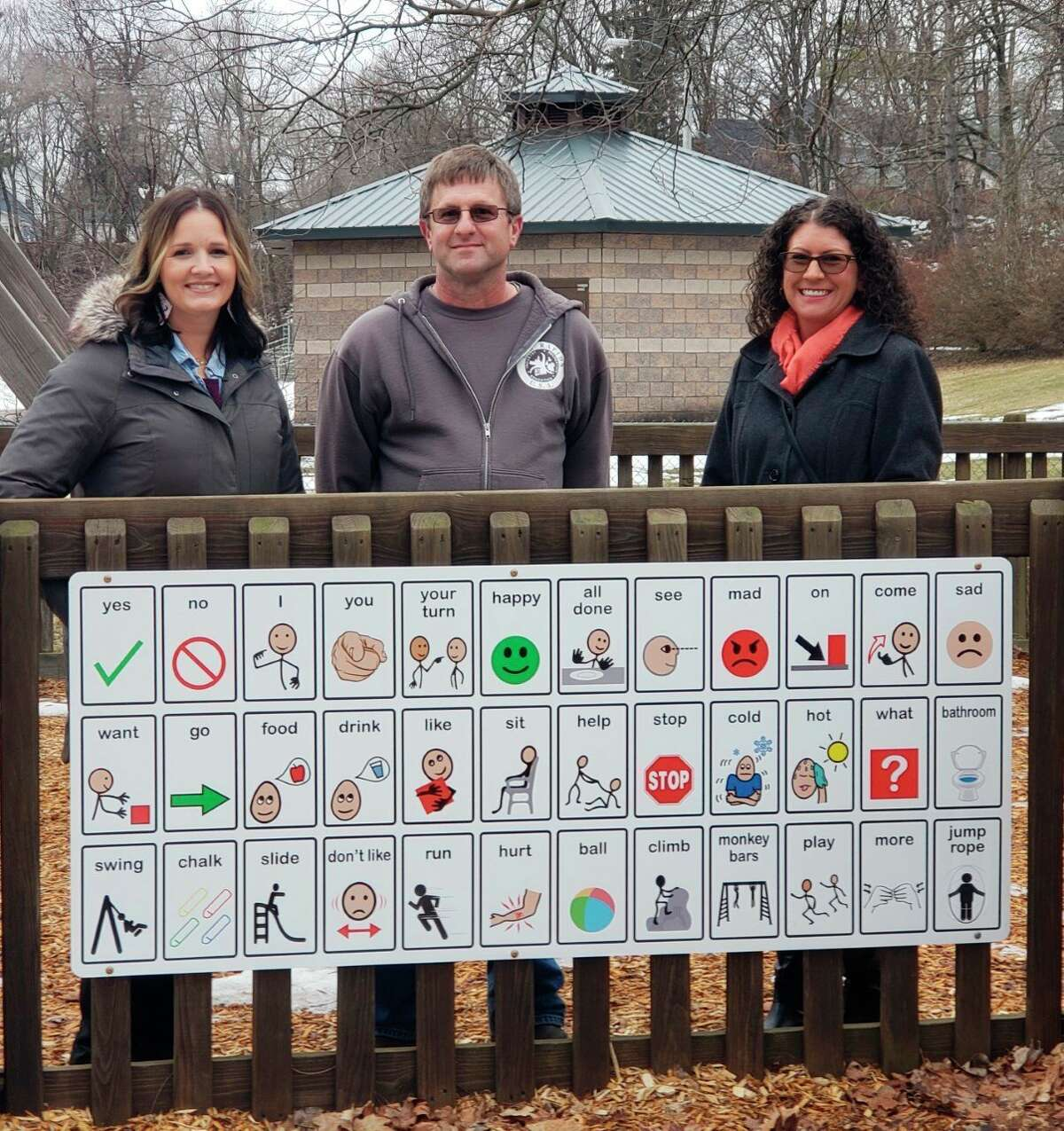 Pictured from left to right are Community Mental Health Program Supervisor Emily Bongard, Parks and Recreation employee Todd Eichler and Director of Public Works Heather Bowman. The group worked together to get the sign installed at Hemlock Park. (Courtesy photo)