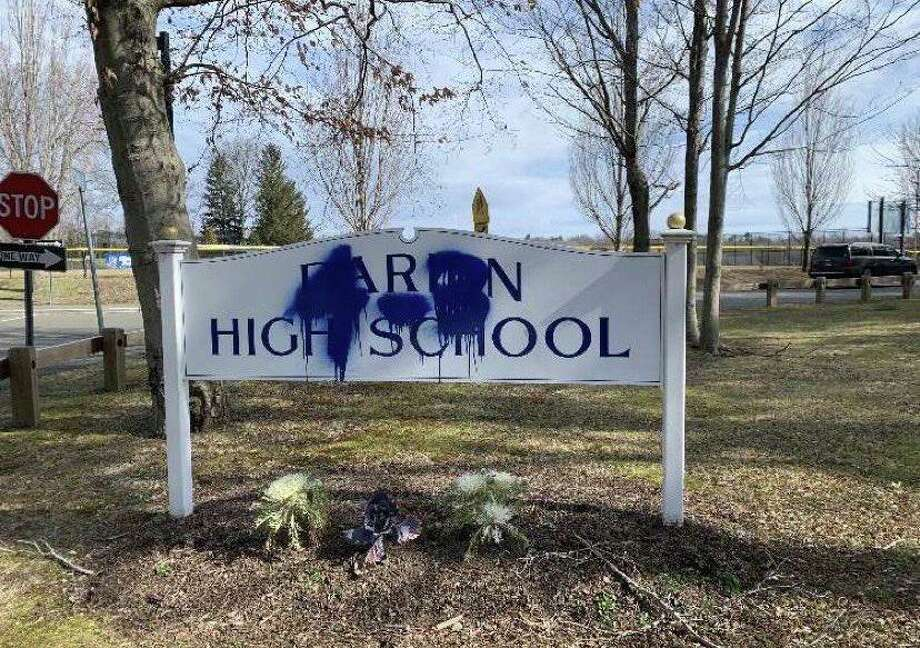A sign outside Darien High School was vandalized over the weekend. Darien Police are investigating. Photo: Courtesy CT HS Hockey Twitter Account /