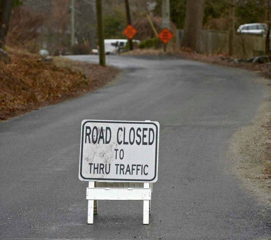 File photo of a road closed sign. Photo: H John Voorhees III / Hearst Connecticut Media / The News-Times