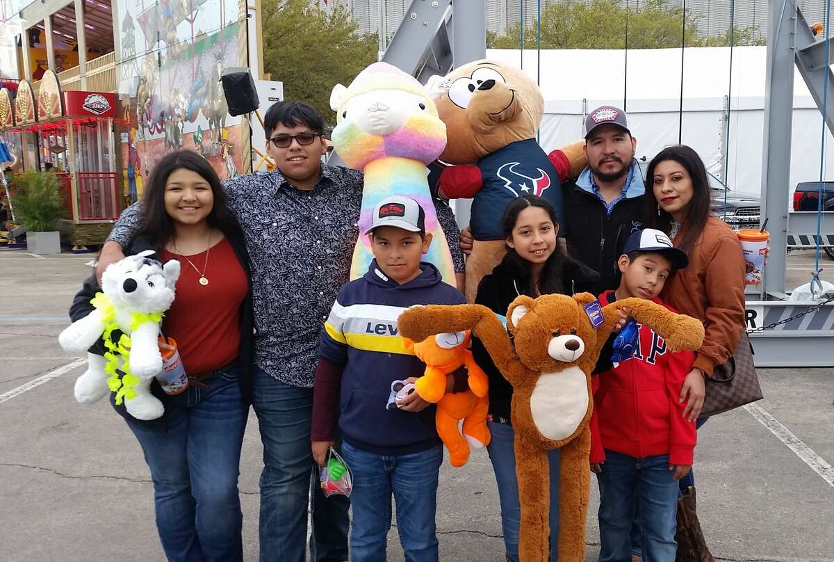 RodeoHouston's carnival is chalk-full of fun games to try your luck with to win some of the biggest and sought-after prizes. Here you can see a few folks proudly posing with many of the grand prizes you'll find scattered throughout the carnival games you can play.