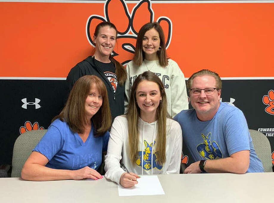 Edwardsville senior Rileigh Kuhns will play college soccer at the University of Missouri-Kansas City. She is joined by her family and EHS coach Abby Federmann. Photo: Matt Kamp|The Intelligencer
