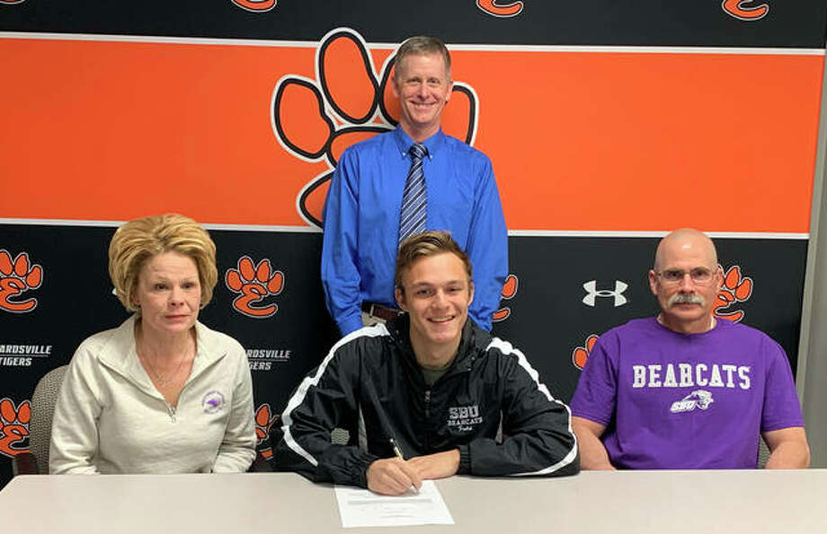 Edwardsville senior Tyler Frolik will play college soccer at Southwest Baptist University. He is joined by his family and EHS coach Mark Heiderscheid. Photo: Matt Kamp|The Intelligencer