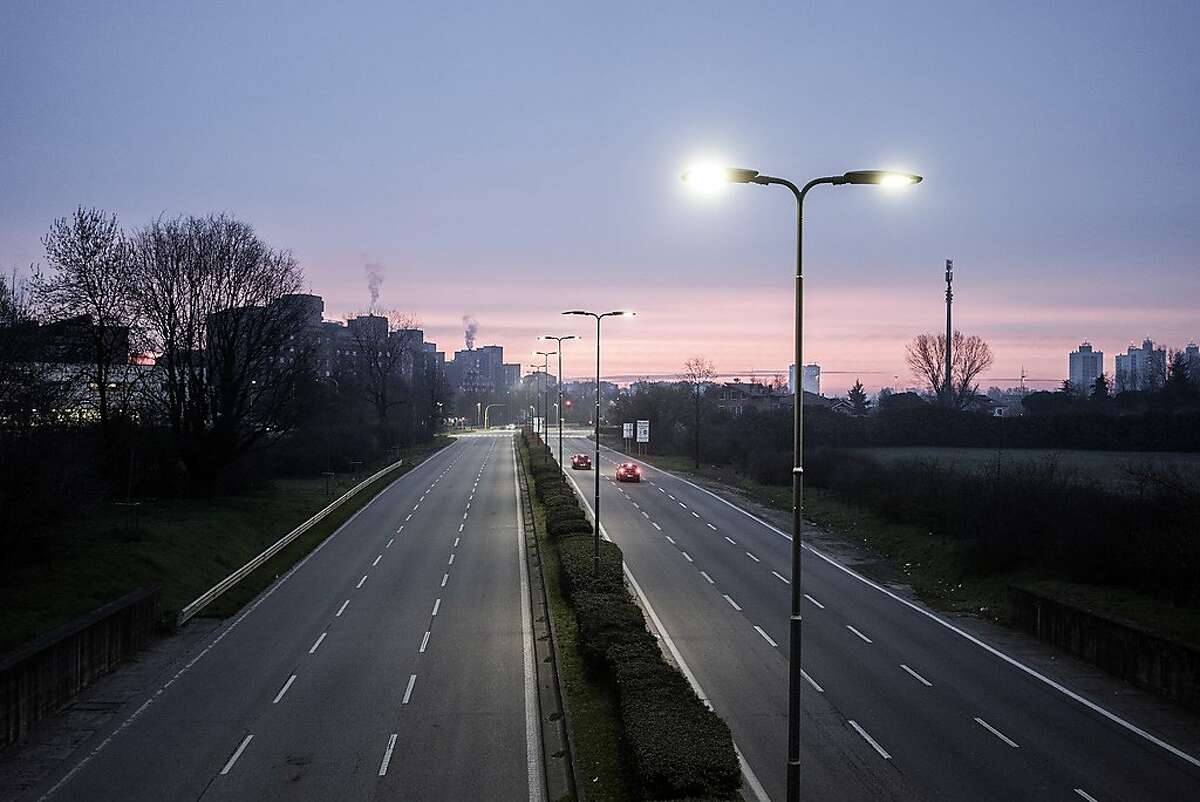An access road to Milan, usually busy with workers, is nearly deserted, March 10, 2020. All of Italy's 60 million people are coming under restrictions that had earlier applied to the northern part of the country. (Alessandro Grassani/The New York Times)