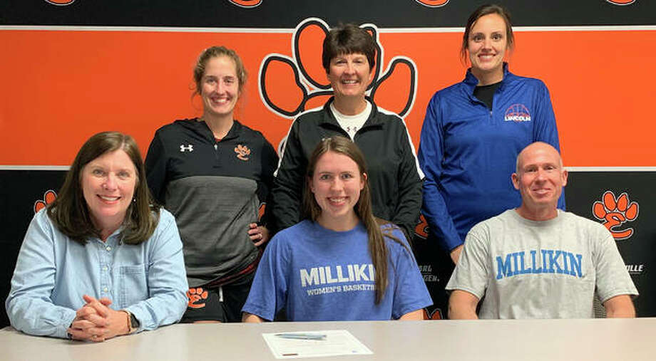 Edwardsville senior Jacquelin Anderson will play women's basketball at Millikin University in Decatur. She is joined by her family and EHS coaches, from left to right, Caty Ponce, Lori Blade and Tonya Holler. Photo: Matt Kamp|The Intelligencer