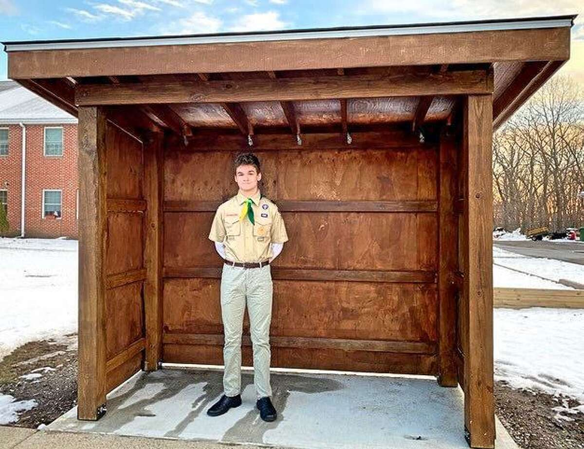 Trumbull High School senior Ben Cousins recently completed a bus shelter at Stern Village. The shelter, which was the final Eagle Scout project from Trumbull Troop 268, took nearly 300 hours to build.