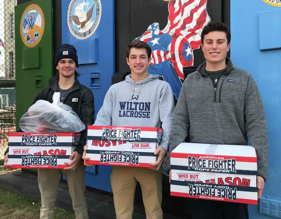 From left, Connor Burke, Jake Zeyher and Jack Savarese deliver socks collected during the Socks for Soldiers Valentine's Day drive. The final drive of the school year will conclude May 10. Photo: Contributed Photo / Wilton High School / Wilton Bulletin Contributed