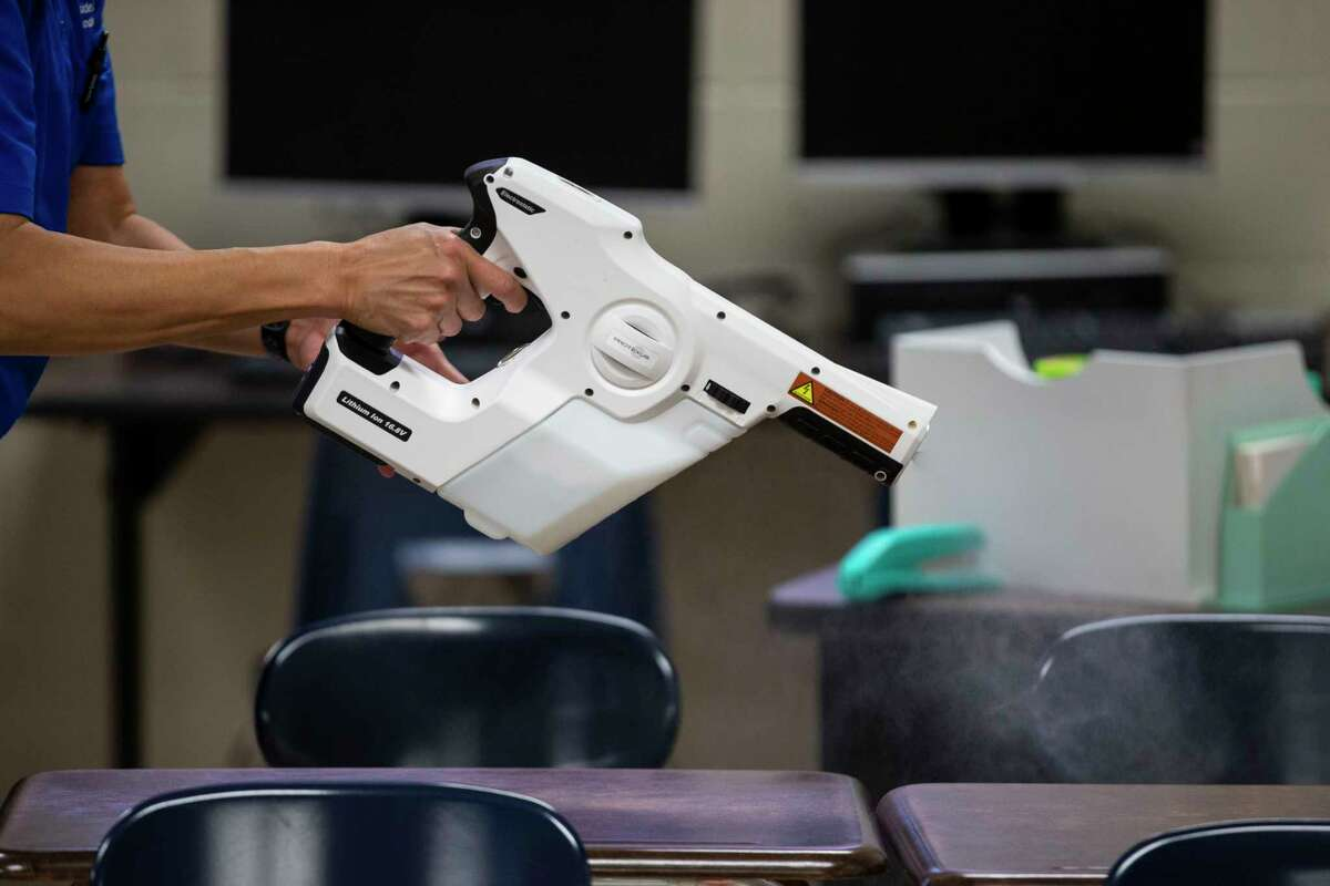 An electrostatic sprayer is used clean the classrooms.