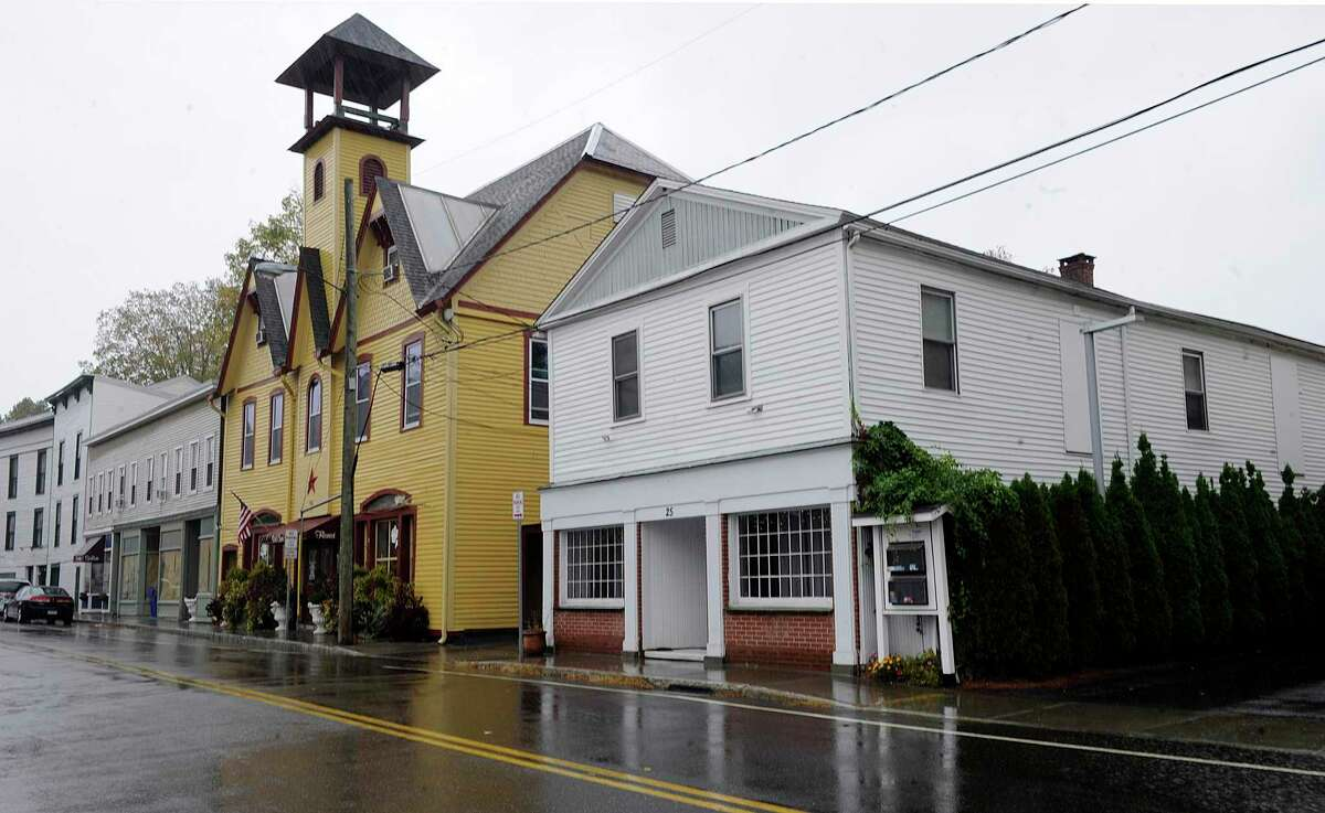 The Town of New Milford is considering an offer by David and Scott Benincasa to purchase the now town-owned 25 Church St. building, right.