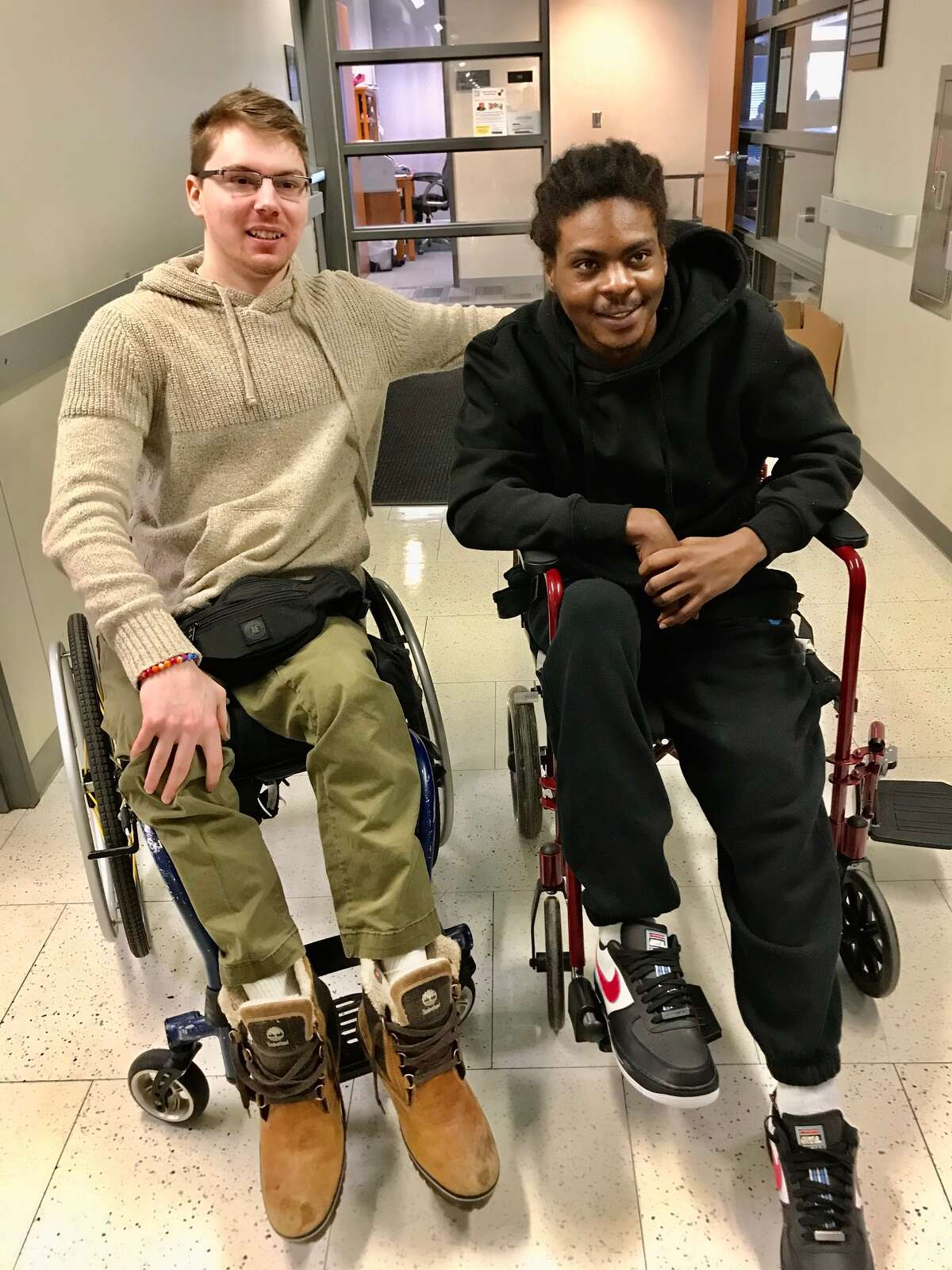 Otto Miller, 22, and Ellazar Williams, 20, forged a bond during a meeting at the Rensselaer lab and made plans to keep connected and help each other confront the challenges of being paraplegics