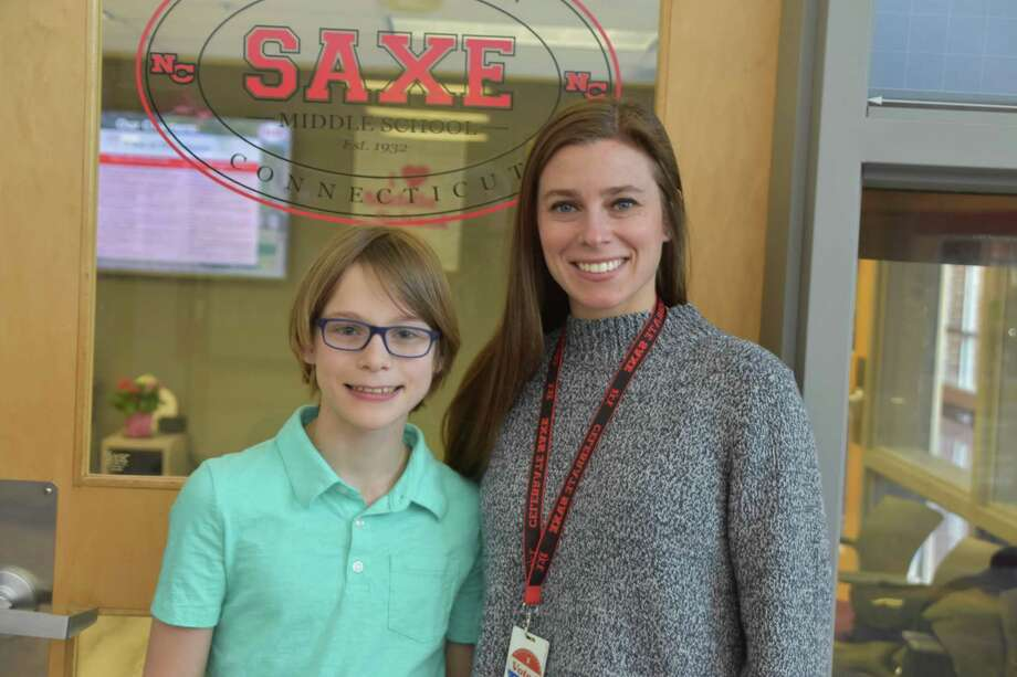 Saxe Middle School sixth grader Rowan Richey Elliot, pictured with sixth grade social studies teacher Christina Fulco, has reached the semifinals of the 2020 National GeoBee. It is the second straight year he has won the geography competition at the school in New Canaan. Photo: New Canaan Public Schools / Contributed Photo / New Canaan Advertiser Contributed